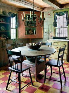 Prim Dining...painted wooden floor & corner cupboard...love the beamed ceilings!