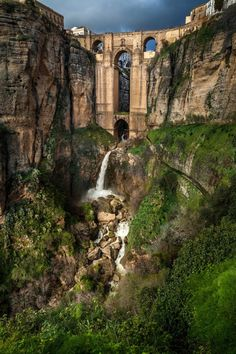Ronda. Ronda is located 100 kilometers west of the city of Malaga. Its population is approximately 35,000. This small town is on a huge cliff, with a magnificent bridge spanning a gorge between old and new Round.