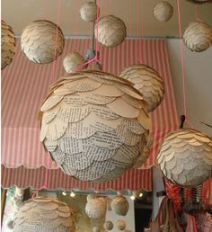 These pine cone shaped ornaments are made with a styrofoam ball center  and book page petals
