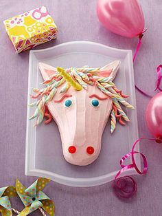 Magical Unicorn: Our handsome horned creature, assembled from a cleverly cut sheet cake, has a flowing mane of colorful marshmallow twists @Phyllis Garcia magazine