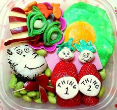 "I think this might be my best work yet. Happy Birthday, Dr. Seuss!  (rice ball & nori Cat in the Hat, carved apple hat & bowtie, green eggs and ham with cheese stick centers, goldfish crackers, strawberry Thing 1 & Thing 2 with ""Milky"" candy heads & tummies, Lik-a-Stick colored Milky candy hair, all on a bed of edamame)"