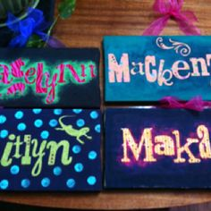 Name signs, made by covering a regular canvas from hobby lobby or Walmart with light colored fun fabric,  then I cut out the names with my Slice© machine, cut them out of regular contact paper, peel off the letters' back, press them onto the board of fabric, paint the entire board (I used regular craft acrylic paint bc spray paint makes the letters curl up), after the paint dries, peel off the letters to reveal the fabric letters :), apply a ribbon to hang it from, maybe some rhinestones for bling bling!! Awesome personalized Christmas gifts, oh, & I got this from pinterest!!!  Check out my pins in 'Crafties' to see the original idea!