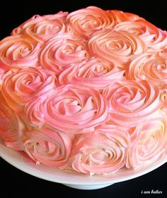 Easy to do Rose Cake Tutorial. So pretty! Tried this on cupcakes. Needed a bigger attachment for my piping bag. Next time, want to try it with the spray, like in the picture! Or all white. So pretty that way!