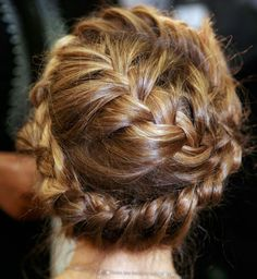 During the Valentino's spring 2012 runway show, the models came sashaying down the runway with these gorgeous French braids wrapped around their heads, which would look absolutely stunning on a bride. According to the hairstylist, he took large sections of hair at the crown of the head, divided them into three, and started the french braid in the middle moving counter-clockwise by the hairline. Print this out and show it to a professional hairstylist, as this is not a look amateurs can do.