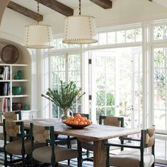 Comfortably chic dining room in film producer Steve Tisch's Beverly Hills home designed by Peter Dunham