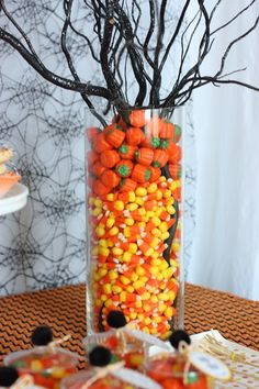 Genius! Use leftover Halloween candy corn and candy pumpkins for an easy and fun Fall centerpiece #partycrafters
