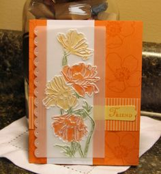 "By BJ Peters. Uses the Stampin' Up/Sizzix ""Flower Garden"" embossing folder on vellum. Turn to reverse side to color with markers. Stamp flowers from ""Fabulous Florets"" (Stampin' Up) on the card front in ink that matches the cardstock. Video tutorial on her website."