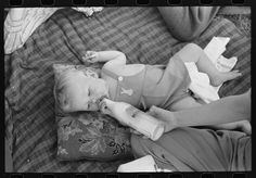 """Baby at a picnic, no diaper on but one there """"just in case"""" it seems.  1941, Oregon"""