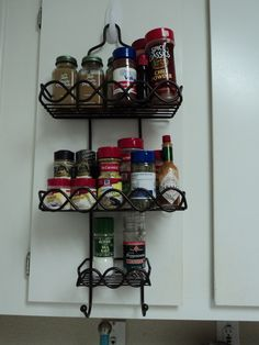 Small kitchen solution. Use shower organizer to hang spices on cabinet door. Easy access and frees up lots of   cabinet space!