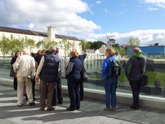 A group enjoys a free EHOD walking tour of Ebrington Barracks with NIEA Principal Conservation Architect Manus Deery.