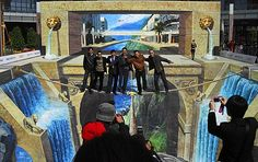 Optical illusion created by the worlds largest 3D pavement painting.