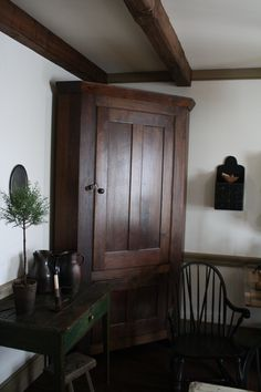 Love this corner cupboard