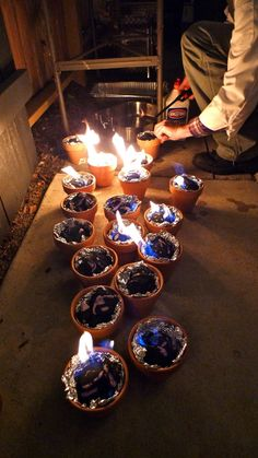 Light charcoal in terracotta pots lined with foil for tabletop s'mores.