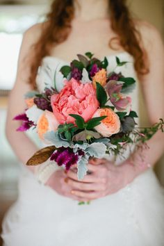 a wild bouquet with almost every color in the rainbow  Photography by http://carmensantorelli.com, Event Styling and Floral Design by http://julivaughn.com