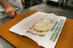Chuck E. Cheese's new gluten-free pizzas are delivered to restaurants in a factory-sealed bag. The kitchen staff bakes the pie in the package, and when it arrives at the table, an adult patron opens it. The pizza also comes with a disposable cutter to prevent contamination.