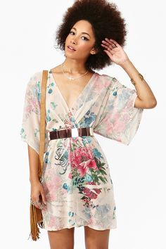 Flowy floral print chiffon dress featuring a wrap top and kimono sleeves. Sublimated detailing, stretch panel at waist. Unlined. Looks perfect paired with ankle boots and a fringe bag!