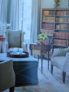 four chairs one ottoman, subtle green blue hues