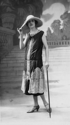 A low-waisted dress augmented with lace panels, worn at a Paris fashion show, 1926.