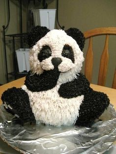 3D Panda Bear using Wilton 3D Bear pan. I used grass tip 233 for white fur except the muzzle and between eyes I used star tip. I used star tip for all of the black.