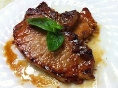 Honey Garlic Pork Chops - 4 ingredients! Honey, Soy Sauce, Garlic & Pork bake at 350 for 30 minutes.