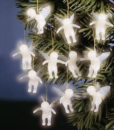 Small ornaments spray painted with glow-in-the-dark paint. These would be fun along our pathway - make them look like fairies!---need to find my xmas. cherubs ( naked babies with wings ) cute idea