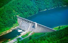 The Sutton Dam, located just upstream of Sutton and 101 miles above Charleston, is an imposing structure. It straddles Elk River at a height of 210 feet, with a top length of 1,178 feet. The dam controls a drainage area of 537 square miles, and creates a 1,520-acre lake at summer pool stage. The summer pool depth near the dam is 112 feet.