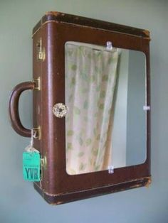 Turn an old case into a jewellery box (or even a bathroom cabinet)