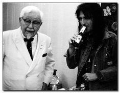 Colonel Sanders hanging out with Alice Cooper.