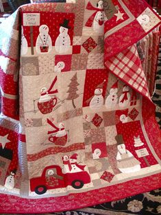 Chandeliers, Lanterns & Mirrors...The Homespun & Holly Recap! - Boughs of Holly---I love this Christmas quilt---I could wrap up in it all winter long, which in Texas isn't very long but I'd still enjoy wrapping up in it! LMD