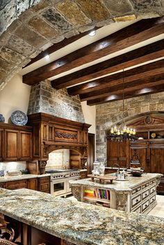 Exquisite beam work in kitchen with Stone detail. Lovely