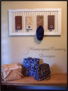 Hang a shutter, cut a shutter, glue on some door knobs... There ya have it! A coat or hat hanger!