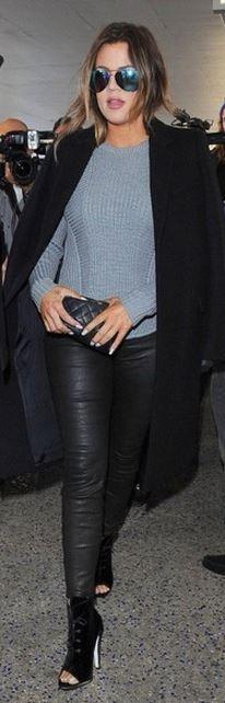 Khloe Kardashian: Sweater – A.L.C.  Pants – J Brand  shoes – Off-White  Purse – Chanel