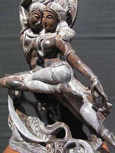 The God Shiva dancing with Parvati, the second wife of the former. Parvati is the highest Mother Goddess in Hindu religion from whom all Hindu goddesses were born and fill the universe. In an intimate and harmonious erotic and mystical dance, Shiva and Parvati are united to make the whole universe balanced and alive.
