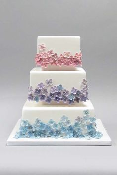 Tiers of Tiny Pastel Flowers on White Cake
