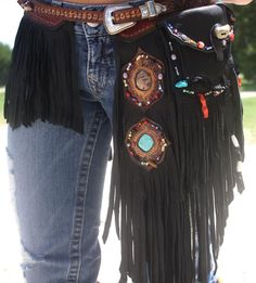 HANDMADE Dream-Weaver fringe belt with pouch features HANDCARVED belt strap with layers of HiGh-quality fringe. BelT and pouch are then adorned with turquoise, CorAL and Bone.