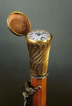 This stick of light-coloured cane has a gold handle decorated with engraved rocaille ornament. The upper lid is hinged and inside there is a watch made by the English clockmaker T. Fitter.  Belonged to Emperor Paul I.