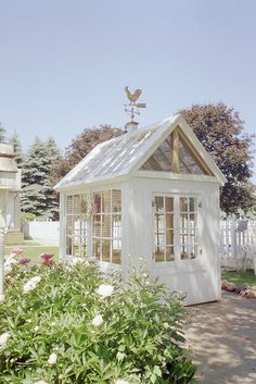 Garden shed from salvaged windows.  One day!!
