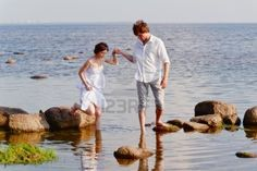 young romantic pair walks at water Stock Photo