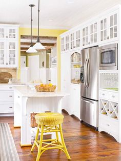 Classic white kitchen with yellow accents