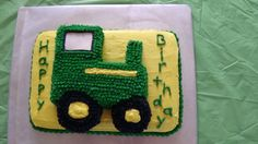 John deere cake I made for my sons 4th birthday.  The bottom cake is a 9x13 then the tractor is made from pieces of another cake the tires I cut out w/ a glass and a donut cutter for the small one.  I then star tipped it all #18.   turned out great and my son loved it!!!
