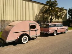 vintage pink travel trailer and station wagon