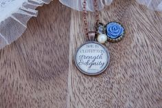 She is Clothed With Strength and Dignity Long Pendant by Lousje