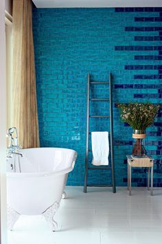 A bathroom with monochromatic blue ceramic tile for the wall - Marie Claire Maison