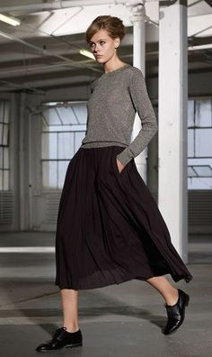 This is so how I dressed in the 90's...pleated skirt, long sleeved crew, and clunky heeled shoes only less fashionable. LOL!