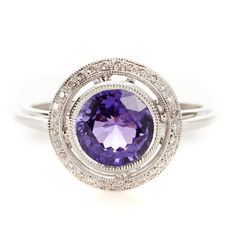 A rarity in the world of gems, a unique purple sapphire jewel takes center stage in this round, white gold ring with milgrain and micropave diamond encrusted borders.  #FingerParty  Beverley K at Greenwich Jewelers, $2325
