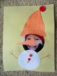 Adorable Snowman craft using a photo, construction paper, and buttons.