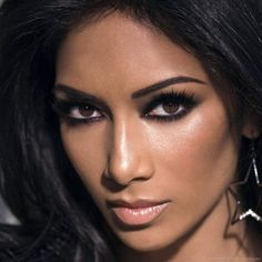 I find her so stunning! beautiful hair, makeup,skin!  Nicole Scherzinger