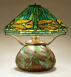 "16"" Dragonfly on Mosaic Urn Base  Reproduction Lamp - 16"" shade designs make a great decorating statement in any room. The variety of design options and limitless color combinations are extremely versatile and prefectly suited to enhance any design concept. These shades are often used as petite chandeliers in breakfast nooks and dens."