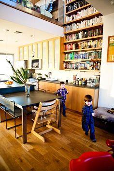 Bookshelf wall in kitchen