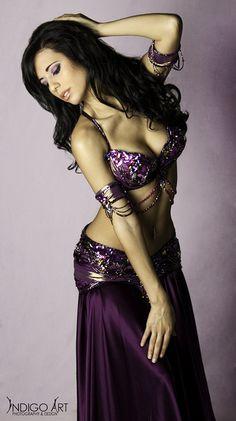 Ameera in a majestic purple custom Bella costume.
